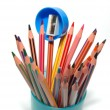 Pencil sharpener and crayons - Stock Photo