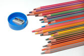 Crayons and sharpener — Stock Photo