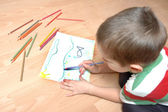 Child with crayons — Stock Photo