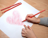 Child draw red heart — Foto Stock