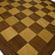 Wooden chessboard - wide angle — Stock Photo #1940213