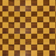 Large wooden chessboard patern — Stock Photo