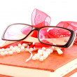 Leather diary with glasses and beads — Stock Photo