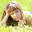 Girl lying in the garden — Stock Photo