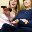Mother and daughter watching tv — Stock Photo