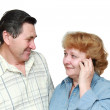 Old couple. The woman speaks by a mobile phone with happy. Isolated — Stock Photo