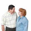 Old couple. Look of each other with love. Isolated. - Stock Photo