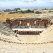Half-destroyed amphitheatre in the mountains of Turkey. Pamukkale - Stock Photo