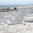 White limy cascades of flowing down calcium water in Turkey. -  