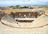 Half-destroyed amphitheatre in the mountains of Turkey. Pamukkale — Stock Photo