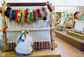 Small weaving mill. The woman behind work - weaving a carpet of silk — Stock Photo