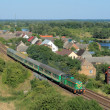 Stock Photo: Landscape with the train, village and ri