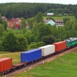 Landscape with the train and a village — Stock Photo