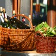 Baskets with bottles of wine and salads - Stock Photo