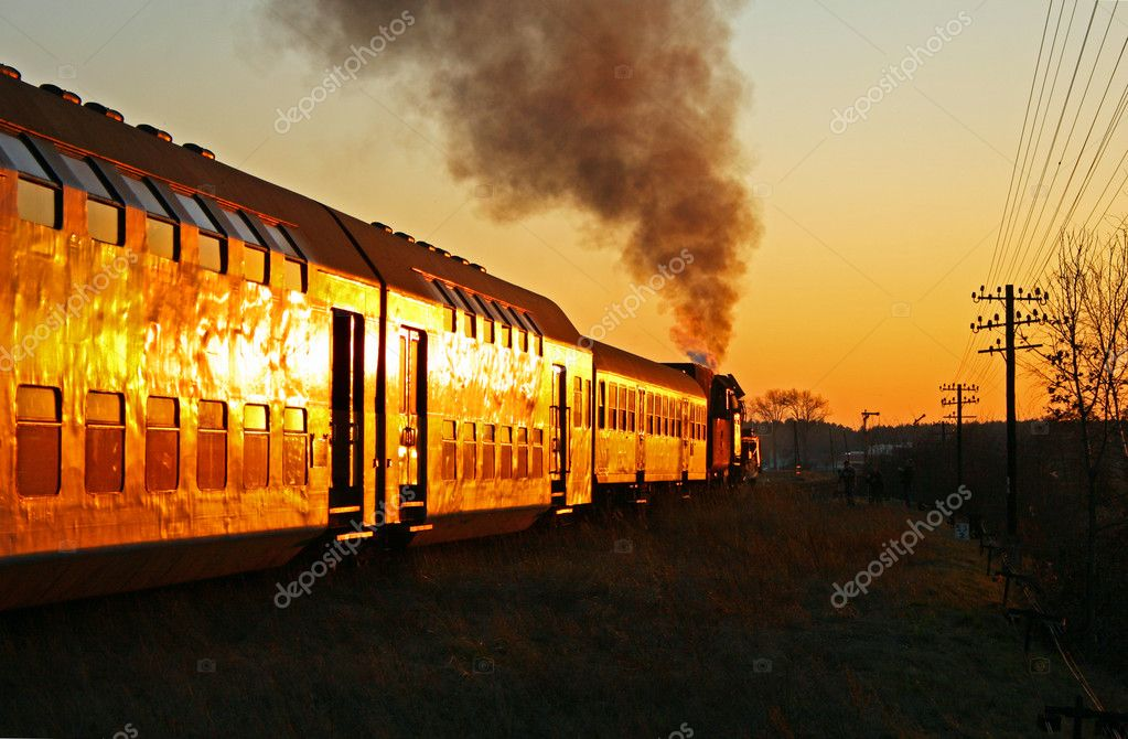 Steam train starting from the station during sunset — Stock Photo #1887430