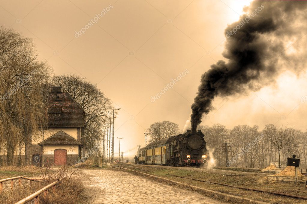 Old retro steam train stopped at the small station  Photo #1887432