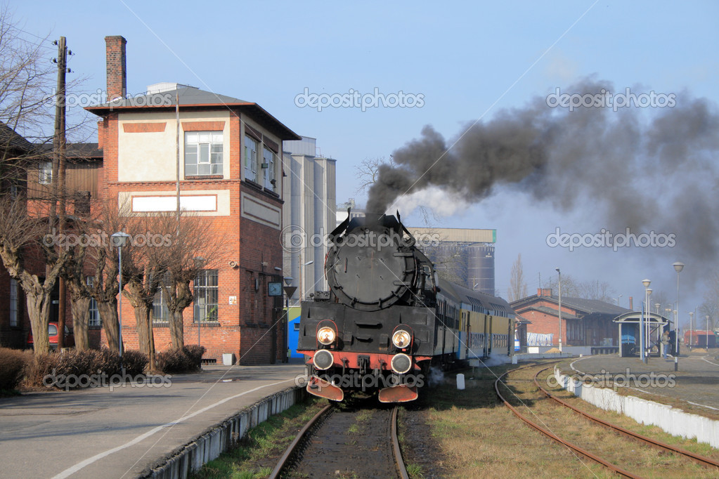 Old retro steam train stopped at the small station — Stock Photo #1887700