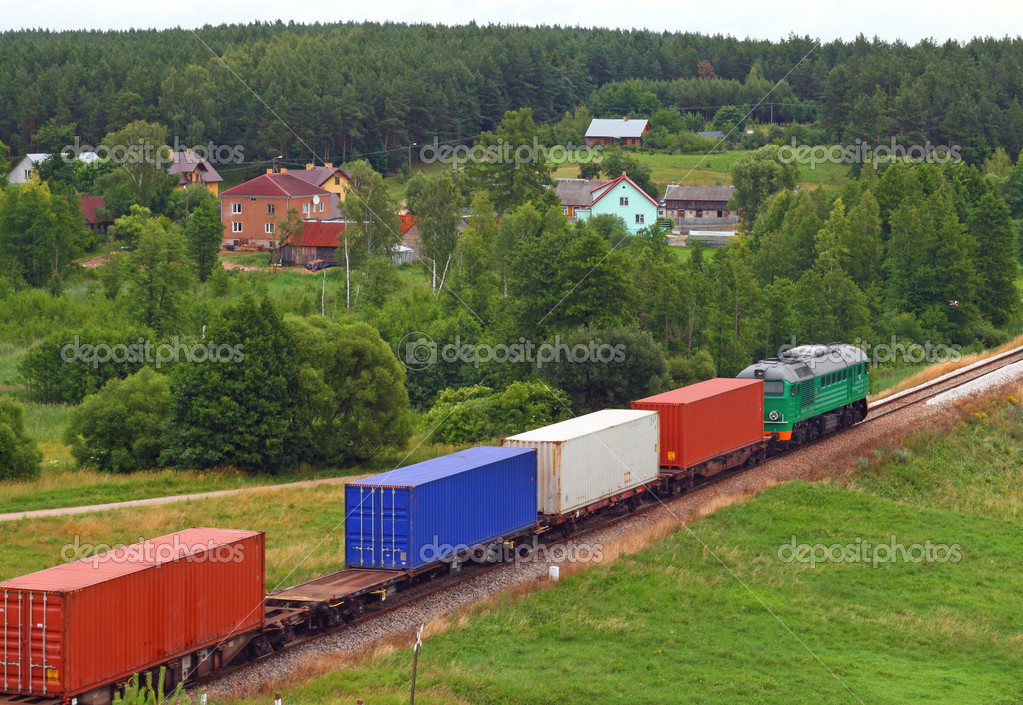 Rural landscape with the container train passing through countryside  Stock Photo #1888682