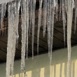 Stockfoto: Icicles on roof