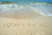 在海滩上签名 — 图库照片
