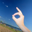Hand up to blue sky — Stock Photo