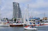 Sailboat entering the marina — Stock Photo
