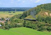 Paisaje con un tren de vapor — Foto de Stock