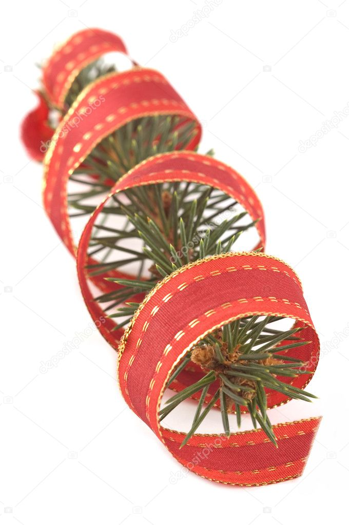 Pine branch with a christmas ribbon isolated on white — Stock Photo #1890211