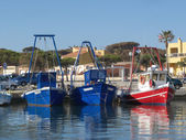 Blue and red fisher boats — Stock Photo