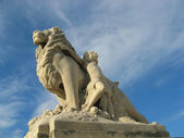 Lion and child statues — Stock Photo
