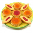 Tarts on a yellow plate - Stock Photo