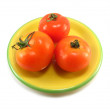 Tomatoes on a yellow plate — Stock fotografie