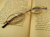 Glasses on a book — Stock Photo