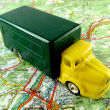 Yellow truck on a map — Stock Photo