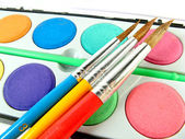 Watercolor box and paintbrushes — Stock Photo
