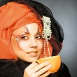 Young woman in black and orange turban — Stock fotografie