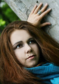 Portrait of young woman in blue scarf — Stock Photo
