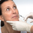 Cosmetic treatment with botox injection — Stock Photo #1907161