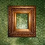 Golden frame over grunge green wallpaper — Stock Photo