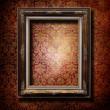 Wooden frame over grunge wallpaper — Stock Photo