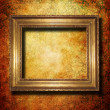 Wooden frame over grunge wallpaper — Stock Photo #1907593