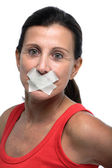 Woman with mouth taped closed — Stock Photo