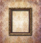 Golden frame over vintage wallpaper — Stock Photo
