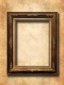 Wooden frame over vintage wallpaper — Stock Photo