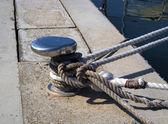 Chrome capstan with white ropes — Stock Photo