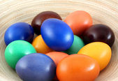 Color easter eggs on plate — Stock Photo