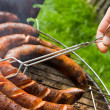 Sausages roasting: grilling — Stock Photo #2260850