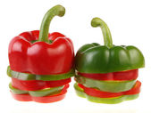 Green and red piece bell peppers — Stock Photo