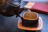 Pouring green tea. — Stock Photo