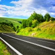 Empty road and cloudy sky - Stock Photo